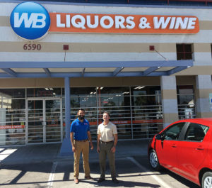Picture of Miguel Valenzuela, El Paso District Manager , WB Liquors & Wine & Leiferman Enterprise President Jacob Leiferman with store sign