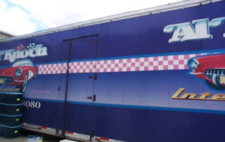 Vehicle graphics on transport trailer