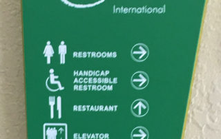Engraved-in-the-back Directional Sign