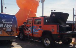 Vehicle graphics on orange truck