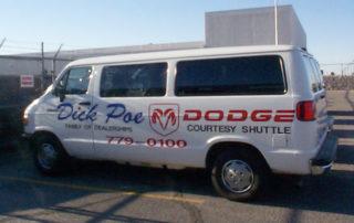 Vehicle graphics on courtesy shuttle van